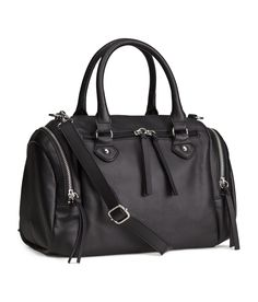 Black bowling bag in embossed faux leather with double handles and top zipper. Detachable, adjustable shoulder strap & three outer compartments with zip. | H&M Accessories
