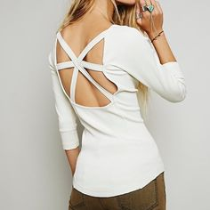Free people star crossed tee Worn two or three times. In great condition. Thick ribbed top with low open back and criss cross detail. Rounded hem. Has a very small hole near one of the seams on the front. In color ivory/cream. Debating on whether or not to sell, comment if interested. Free People Tops Tees - Long Sleeve