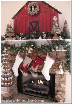 LOVE this Christmas Mantel - look at how cool the trees are made with wood slices, bulbs, and pine cones. Awesome!