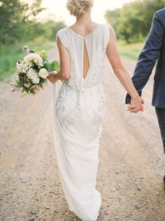 Beautiful Vintage style wedding dress with key hole back and delicate beading