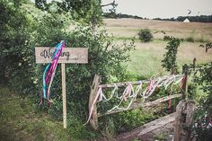 Rustic Wedding Sign & Streamers - Rustic Glam Tipi Wedding With Pink Peony Bouquet & Bride In Leather Jacket Planned by Gordon Malone Images From Claire Penn Photography