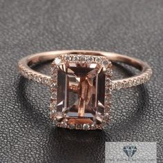 Morganite is the only stone I like in rose gold. Rose gold just looks cheap to me any other way. I hate it when it's mixed with yellow or white gold. Emerald Cut Morganite Engagement Ring Diamond Halo Morganite Ring in Rose Gold Morganite Engagement, Rose Gold Engagement Ring, Halo Engagement, Halo Diamond, Diamond Rings, Black Diamond, Sapphire Rings, White Diamonds, Rose Gold Rings