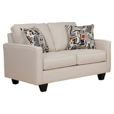 A classic addition to your library or living room, this traditional loveseat features neutral upholstery to complement any color scheme.