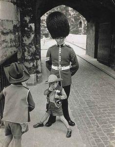 Children playing around a guardsman, London, England, 1963, by Hans Hammarskiöld.
