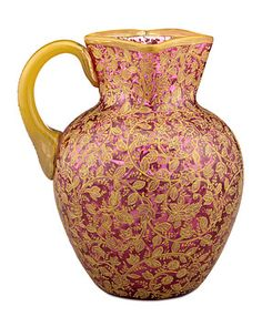 """This graceful and rare square-neck pitcher by the legendary Moser glass company is exceptional in both quality and artistry. Crafted from dramatic cranberry glass, the outstanding vessel is luxuriously adorned with the gold foliate overlay that is Moser's hallmark. Established in 1857, Moser earned a worldwide reputation for their high-quality workmanship and artistry, exhibiting at various world exhibitions and garnering a number of awards. Often referred to as """"The Glass of Kings,"""" Moser…"""
