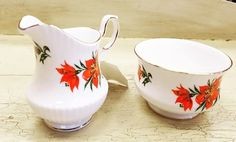 For collectors put there...we have some fab finds to bid for on our current online auction. These beauties are Tiger Lily bone China  <3  Register to bid today! https://auction.blackpearlemporium.ca/m/#/auction/23/item/queens-bone-china-tiger-lily-cream-sugar-set-311 #collingwood #auctions #furniture #giftideas
