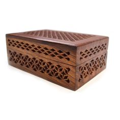 Crafted of shesham wood, by talented Indian artisans, this beautiful wooden box features a detailed cut-work design, complete with brass hinges for easy opening. Store your favorite or treasured items in this beautiful wooden box.