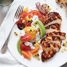 Grilled Chicken with Tomato-Avocado Salad I MyRecipes  The homemade buttermilk dressing balances the heat of the chicken and completes the meal.