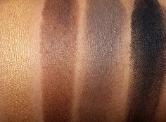 MAC Maleficent Swatches from the left: Goldmine, Ground Brown, Concrete and Carbon