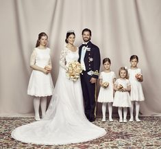 Bridal party: The happy couple with Sofia's bridal party, including Princess Estelle (second right), who is second in line to the throne and the daughter of Crown Princess Victoria and Prince Daniel
