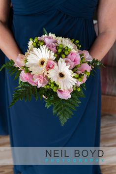 Navy blue bridesmaid dress with pink  white flowers.  Neil Boyd Photography.  Raleigh wedding photographer.