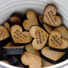 <p>Luke's mum found some adorable Scottish oak hearts online, which could be personalised with your names and wedding date. The couple decided these would be the perfect wedding favours – particularly as they married in the Oak Room!</p> <p>They also decorated the reception with plenty of bunting, and display flowers and buckets of sweets on the wedding tables.</p> <p>Instead of a post box, Charlotte had her grandma's vintage suitcase, which was a lovely way to include memo...