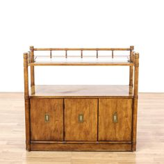 This console table is featured in a solid wood with a glossy walnut finish. This traditional style TV stand has a glass top, 2 bottom side cabinets with ample storage space and pull-out drawers. Perfect for storing DVDs! #americantraditional #tables #consoletable #sandiegovintage #vintagefurniture