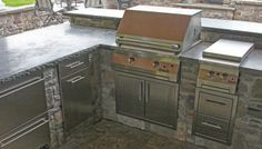 Stainless cabinets for outdoor kitchen in stone or masonry