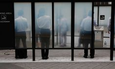 People smoke cigarettes at a smoking booth on a street in Tokyo August REUTERS/Issei Kato Tobacco Industry, People Smoking, Free Market, Environment Design, The Guardian, August 25, Kato, Industrial, Smoke