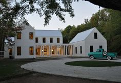 modern farmhouse {GTH Architects}  I think the truck is the selling point!