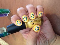 Mardi Gras bead nail design- yellow nail polish with green and purple dots applied with dotting tool. Super easy!