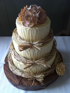 Rustic Wedding Cake — It is hard to set your cake apart from all the other beautiful cakes out there, but this one succeeds beautifully..