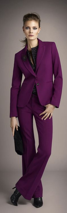 Okay... we must agree that this ís in fact a suit... However, we would NOT recommend any of you wearing it, as non of you are the pink/purple panther. In addition to this color... the shoes are all wrong. However, this color is well suited for a blouse or maybe pencil skirt.