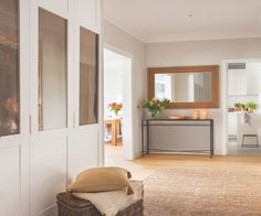 Kitchen at far end of entry hall. Hall has lots of storage in built-ins. Inez, Blanca, Carmen - sister's, architect, interior designer & owner of renovated home. Floor Rugs, Floor Chair, Entry Hallway, Wardrobe Design, Built Ins, Small Spaces, Sweet Home, Flooring, Interior Design