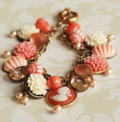 The multicolor cabochon bracelet uses polymer clay cabochons and glass rhinestone cabochons to decorate a vintage charm bracelet. These flower shaped beadings are great mix of peach and cream.