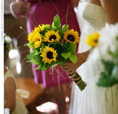 sunflower boquets with red | Bright sunflowers combined with greenery gave Helen's bridal bouquet ...
