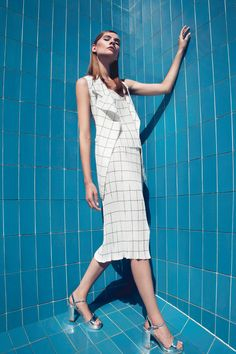 "Vassiliki Charitou's collection ""The flow"" is inspired by the decade of and is defined by pleated fabrics and window pane patterns. Pleated Fabric, Spring Summer 2016, Contemporary Fashion, Model Agency, Ss16, Digital Photography, White Dress, Style Inspiration, Coat"