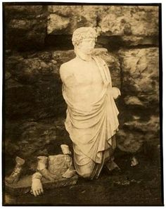 statue of Osiris-Antinous from Eleusis in a photograph taken in 1860 by its discoverer, the French archaeologist François Lenormant (1837–1883)