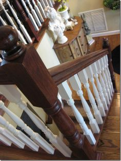 Update an oak banister by staining it.  I used Polyshades Bombay Mahogany. The beauty of Polyshades is that it's stain and poly all in one. I did NOT sand, prime or do any prep to my railings, I simply brushed on the Polyshades to darken and deepen the color of the stain.