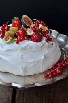 Pavlova...a cloud of merengue topped with fresh & exotic summer fruit...It's nice to see beautiful old school desserts return...Floating Island anyone?