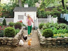 Coop designed by Jimmie Henslee. Raised beds and lattice fence by Kurt Rowe. The chicken coop was inspired by outbuildings from Colonial Williamsburg. Stone Raised Beds, Raised Garden Beds, Backyard Chicken Coops, Chickens Backyard, Chicken Fence, Chicken Garden, Building A Chicken Coop, Garden Fencing, Potager Garden