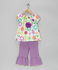 Stripes, flowers and flair—there's no limit to the mixing and matching possibilities of this super-sweet set. With the stretchy waist on the pants and the peasant top's rosette accent, this ensemble can liven up any day simply and beautifully.Includes top and capri pants100% cottonMachine wash; hang dry