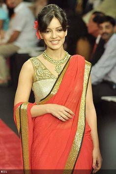 Ishita Sharma walks the ramp for Jewellery brand Gitanjali 'Beti' during the third season of India International Jewellery Week (IIJW) in Mumbai on August 19, 2012.