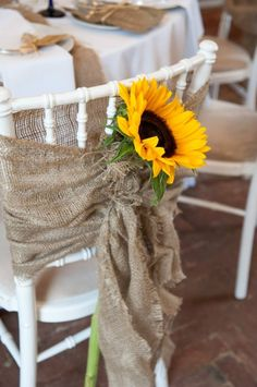 Country style chairbacks - hessian ribbons and sunflowers. Not expensive but very pretty #weddings