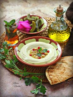 Home made Hummus Middle eastern Arabic dish, usually served as a dip or appitizer! suitable for a breakfast or dinner accompanied with pita bread. To get a silky ,creamy hummus just follow the recipe :)