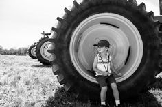 10eleven Photography, Brookfield & Milwaukee Wisconsin Child & Family Photographer, Breakfast on the Farm 2017, Golden E Dairy Farms, West Bend, Photos of big tractor wheel and boy, black and white