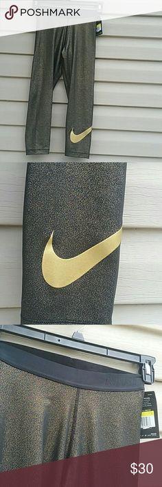 NIKE Dri fit training capri pants NWT Black and Gold Nike training pants 88%polyester  12 % spandex size S Nike Pants Capris