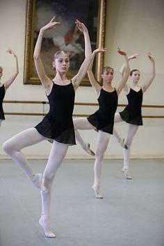 Vagonova style: black leo, black skirt, white tights and white shoes.
