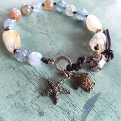 Sterling silver star fish, bronze turtle, citrine, leather bracelet #beachfashion #handmadejewelry #bohobracelet #bohemianjewellery #bohochicbracelet #starfishbracelet #turtlebracelet #womensfashion #womenswear #bohemianfashion #uniquegifts #etsyshop • A personal favourite from my Etsy shop https://www.etsy.com/uk/listing/269099368/turtle-starfish-boho-bracelet-stones