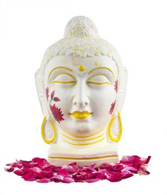 This Buddha head with a serene and peaceful meditating expression will surely provide a tranquil tone to your place. It is intricately and diligently handcrafted by the artisans. This is a unique piece. it is white and is artistically given fine lines with yellow which gives it a mesmerizing look. the pink lotuses painted on the sides of the face make it look magnificent. It would surely add to the beauty and uniqueness of your house.