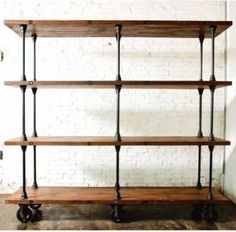 Reclaimed wood and pipe on castors. Can be used to create shelving, community dining tables, serving counters (buffets/bars), coffee tables, moveable room dividers...