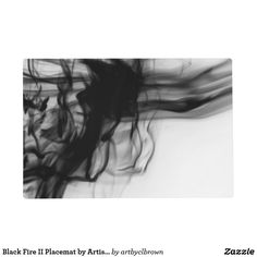 """The Black Fire II Placemat designed by Artist C.L. Brown features fire photography converted to black and white. Make breakfast, lunch, and dinner a delight! These placemats are printed double-sided in full vibrant color then coated with a satin UV layer for an added protection. This is a one-of-a-kind placemat that is fun to use and easy to clean with a damp cloth. Tested and approved for food contact. Dimensions: 12"""" x 18"""" (rounded corners)."""