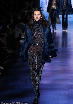 She wore blue velvet: Siren Bella looked somber as she showed off a wintery look