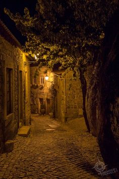 If you're looking for an off-the-beaten-path town in Portugal that is sure to enchant you, look to Monsanto, a town built in, on and around giant boulders. Portugal Vacation, Portugal Travel, Oh The Places You'll Go, Places To Travel, Places To Visit, Beautiful World, Beautiful Places, Night Aesthetic, Fantasy Landscape