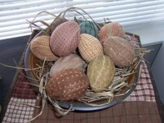 fabric wrapped eggs...can be plastic..wrapped in fabric strips and distressed. Love this idea for spring!