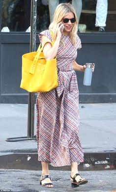 Relaxed: The 36-year-old looked effortlessly stunning in a checked summer dress and vibran...