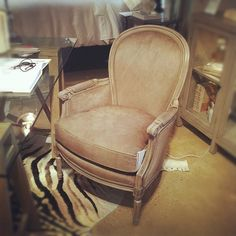 Traditional hair on hide chair at Drexel Heritage.  #hpmkt #design #trends