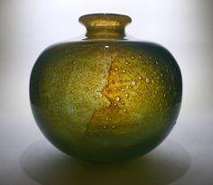A rare Japanese bottle globe vase signed 'Michael Harris Mdina glass Malta'.