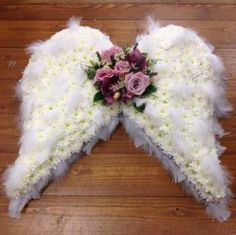 Order Angel Wings/Cushions,Roses flower arrangement from Gene's Floral Creations, your local Brooklyn Park, MD florist. Send Angel Wings/Cushions,Roses floral arrangement throughout Brooklyn Park and surrounding areas. Grave Flowers, Cemetery Flowers, Funeral Flowers, Angel Flowers, Pink Flowers, Arrangements Funéraires, Funeral Floral Arrangements, Funeral Sprays, Cemetery Decorations