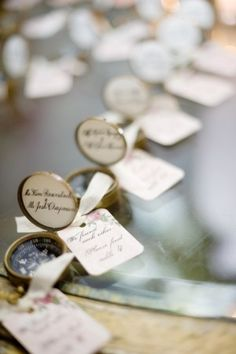 """table numbers using compasses  """"we found each other, please find table #..."""" cute!"""